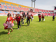 """19 NOVEMBER 2013 - BANGKOK, THAILAND: Red Shirt supporters file into Rajamangala Stadium before a Red Shirt rally in Bangkok. As many as 30,000 """"Red Shirts"""" are expected in Bangkok this week ahead of a Thai court ruling that could cause the collapse of the government of Yingluck Shinawatra, the Prime Minister. The Red Shirts are gathering in a suburban sports stadium before marching to the court. The Red Shirts are mostly farmers and rural Thais who support the Shinawatra government.     PHOTO BY JACK KURTZ"""