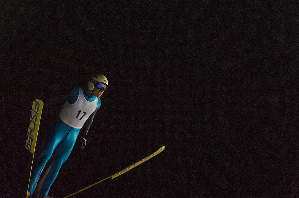 Ski jumping at night during a tournament at Suicide Bowl ski jumping area in Ishpeming, Michigan.