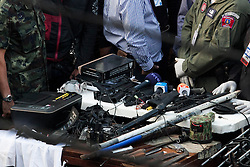 © Licensed to London News Pictures. 17/01/2014. The items including radios, knifes, gun attachments, transmitters and walkie talkies found inside an abandoned apartment of a suspect who threw an explosive device injuring eight people during an anti-government street rally on January 17, 2014 in Bangkok, Thailand. Anti-government protesters launch 'Bangkok Shutdown', blocking major intersections in the heart of the capital, as part of their bid to oust the government of Prime Minister Yingluck Shinawatra ahead of elections scheduled to take place on February 2. Photo credit : Asanka Brendon Ratnayake/LNP