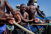 Fishermen are pulling back a net full of fish near the island of Sao Tome, Sao Tome and Principe, (STP) a former Portuguese colony in the Gulf of Guinea, West Africa.