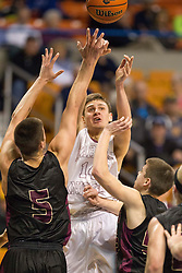 Wheeling Central guard Chase Harler (14) passes the ball in traffic against Williamstown during a semi-final game at the Charleston Civic Center.