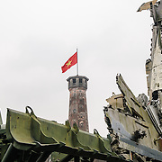 Wreckage from the Vietnam War in front of the the Hanoi Flag Tribune at the Vietnam Military History Museum. The tower was built in the early 19th century (1805-1812) and stands 33.5 meters tall. A 54-step spiral staircase leads to the top, where there is a small viewing room. A national flag has flown atop the tower night and day since October 10, 1954, after the defeat of the French at Dien Bien Phu. The monument has been designated by the Ministry of Culture and Information as a National Cultural and Historic Relic. The museum was opened on July 17, 1956, two years after the victory over the French at Dien Bien Phu. It is also known as the Army Museum (the Vietnamese had little in the way of naval or air forces at the time) and is located in central Hanoi in the Ba Dinh District near the Lenin Monument in Lenin Park and not far from the Ho Chi Minh Mausoleum.