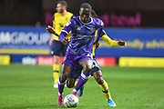 Shrewsbury Town midfielder Ousmane Fane (20) holds up the ball under pressure from Oxford United midfielder Tarique Fosu-Henry  (11) during the EFL Sky Bet League 1 match between Oxford United and Shrewsbury Town at the Kassam Stadium, Oxford, England on 7 December 2019.