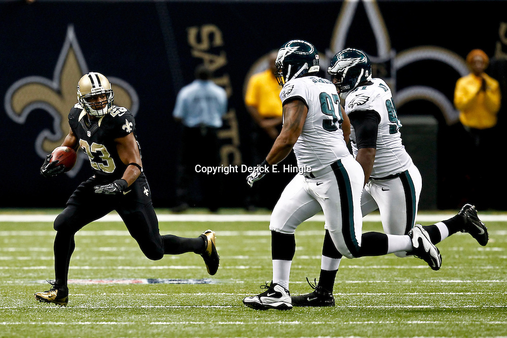 November 5, 2012; New Orleans, LA, USA; New Orleans Saints running back Pierre Thomas (23) is pursued by Philadelphia Eagles defensive tackle Cullen Jenkins (97) and defensive tackle Fletcher Cox (91) during the first half of a game at the Mercedes-Benz Superdome. Mandatory Credit: Derick E. Hingle-US PRESSWIRE