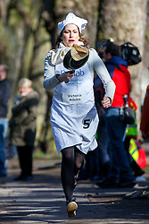 © Licensed to London News Pictures. 28/02/2017. London, UK. VICTORIA ATKINS MP races against Lords and members of media at the annual Rehab Parliamentary Pancake Race outside the Parliament on Shrove Tuesday, 28 February 2017. Photo credit: Tolga Akmen/LNP