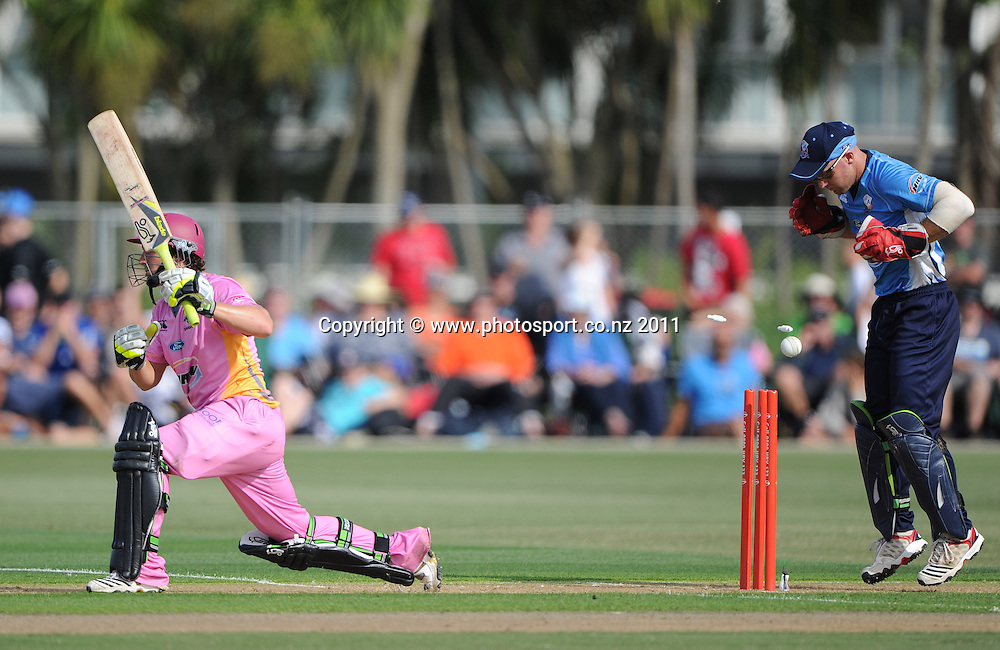 Northern's B J Watling is bowled as Auckland keeper Gareth Hopkins looks on during the HRV Twenty20 Cricket match between the Auckland Aces and Northern Knights at Colin Maiden Oval in Auckland on Monday 26 December 2011. Photo: Andrew Cornaga/Photosport.co.nz