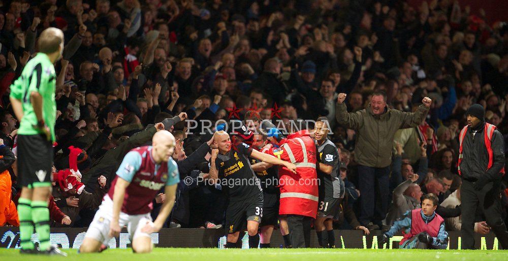LONDON, ENGLAND - Sunday, December 9, 2012: Liverpool's Jonjo Shelvey celebrates scoring the winning third goal against West Ham United in front of the travelling supporters during the Premiership match at Upton Park. (Pic by David Rawcliffe/Propaganda)