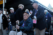 WWII Veterans and their escorts arrive at Stewart International Airport in Newburgh, NY prior to their Hudson Valley Honor Flight to Washington, DC on Saturday, September 27, 2014. Nearly one hundred WWII Veterans from the Hudson Valley region of New York toured the WWII Memorial in Washington, DC and Arlington National Cemetery in Arlington, VA.  © www.chetgordon.com