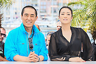 "CANNES, FRANCE - MAY 20:   Yimou Zhang and Gong  Li attend the ""Coming Home"" photocall at the 67th Annual Cannes Film Festival on May 20, 2014 in Cannes, France.  (Photo by Tony Barson/FilmMagic)"