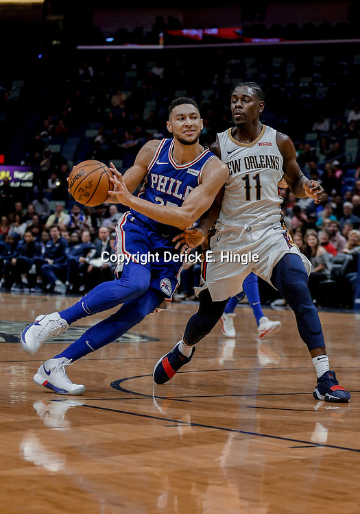 Dec 10, 2017; New Orleans, LA, USA; Philadelphia 76ers guard Ben Simmons (25) drives in against New Orleans Pelicans guard Jrue Holiday (11) during the fourth quarter at the Smoothie King Center. The Pelicans defeated the 76ers 131-124. Mandatory Credit: Derick E. Hingle-USA TODAY Sports