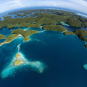 Aerial view of Palau's Rock Islands, abundant coral reefs and surrounding tropical blue ocean