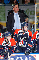 KELOWNA, CANADA -FEBRUARY 1: Head coach Guy Charron of the Kamloops Blazers stands on the bench against the Kelowna Rockets on February 1, 2014 at Prospera Place in Kelowna, British Columbia, Canada.   (Photo by Marissa Baecker/Getty Images)  *** Local Caption *** Guy Charron;