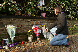 © Licensed to London News Pictures. 29/12/2019. London, UK. ANITA MOFFAT from Nottingham, a fan since 1894, laying flowers outside GEORGE MICHAEL'S former house in north London, after the death of his younger sister, MELANIE PANAYIOTOU. MELANIE PANAYIOTOU'S body was found Christmas Day exactly three years after GEORGE MICHAEL'S death. Photo credit: Dinendra Haria/LNP