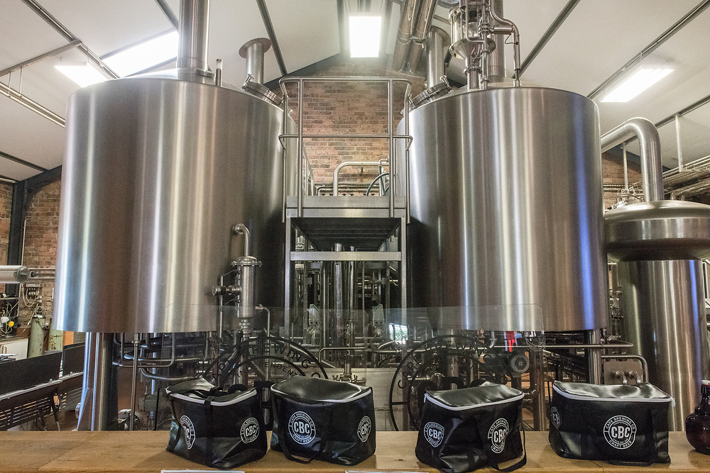 Two metal storage vats containing beer at microbrewery, Cape Town, South Africa