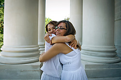 """Donna Branham of Lenore, West Virginia, hugs her friend on the steps of the West Virginia Capitol, just minutes before they both shave their heads in protest to mountaintop-removal mining. The shaving of their heads was symbolic of the mountains that have been stripped of all of the living things on them. It was also symbolic of the many people who are sick or dying as the result of Mountaintop Removal. Mountaintop Removal is a method of surface mining that literally removes the tops of mountains to get to the coal seams beneath. It is the most profitable mining technique available because it is performed quickly, cheaply and comes with hefty economic benefits for the mining companies, most of which are located out of state. It is the most profitable mining technique available because it is performed quickly, cheaply and comes with hefty economic benefits for the mining companies, most of which are located out of state. Many argue that they have brought wage-paying jobs and modern amenities to Appalachia, but others say they have only demolished an estimated 1.4 million acres of forested hills, buried an estimated 2,000 miles of streams, poisoned drinking water, and wiped whole towns from the map. """"People don't know how hard it is on the Appalachian people,"""" Branham said of mountaintop-removal mining. """"They have no idea. And they don't want to know. As long as they don't have to look at it, they can ignore it."""" © Ami Vitale"""