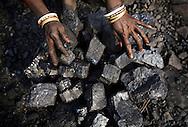 Local villagers carry scavenged coal from an open-cast coal mine in Dhanbad, Jharkhand, India on Dec 5, 2014, tying to earn a few dollars a day. <br /> (Photo by Kuni Takahashi)