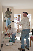 "Dale Squires, David Pereira, Mike Warmington and Rick Moses along with fellow Gilford Rotarians apply a fresh coat of paint to the Family Wing of the Carey House as part of the ""Adopt a Room"" program.  (Karen Bobotas/for the Laconia Daily Sun)"
