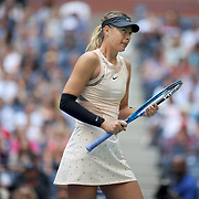2017 U.S. Open Tennis Tournament - DAY THREE.  Maria Sharapova of Russia in action against Timea Babosof Hungary during the Women's Singles round two match at the US Open Tennis Tournament at the USTA Billie Jean King National Tennis Center on August 30, 2017 in Flushing, Queens, New York City.  (Photo by Tim Clayton/Corbis via Getty Images)