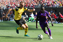 July 22, 2018 - Charlotte, NC, U.S. - CHARLOTTE, NC - JULY 22:Liverpool midfielder Naby Keita (8) with the ball while Borussia Dortmund midfielder Junior Flores (42) during the 2nd half of the International Champions Cup match between Liverpool FC and Borussia Dortmund on July 22, 2018 at Bank of America Stadium in Charlotte, NC.(Photo by Jaylynn Nash/Icon Sportswire) (Credit Image: © Jaylynn Nash/Icon SMI via ZUMA Press)