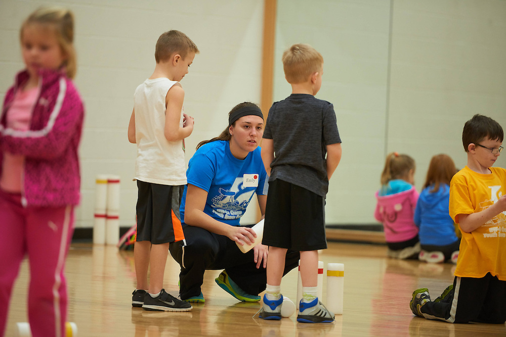 Activity; Teaching; Volunteering; Buildings; Mitchell Hall Fieldhouse; Location; Inside; Time/Weather; day; Type of Photography; Candid; Winter; UWL UW-L UW-La Crosse University of Wisconsin-La Crosse; December; People; Children; Student Students; Woman Women