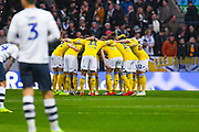 Leeds United players huddle before kick off during the EFL Sky Bet Championship match between Preston North End and Leeds United at Deepdale, Preston, England on 9 April 2019.