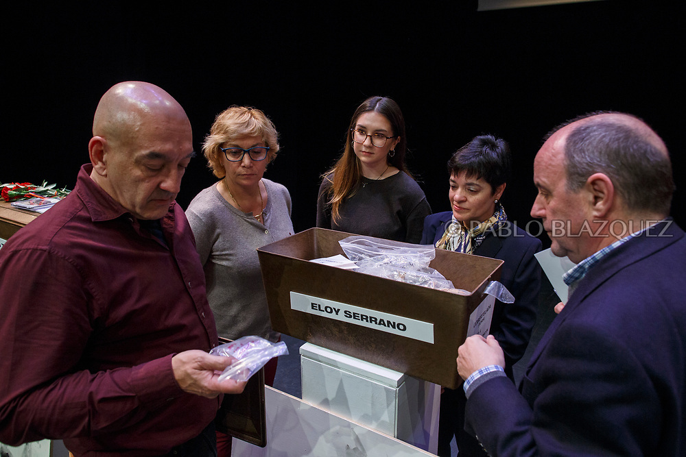 14/04/2018. Victor Illa (L), Jose Maria (R) and other relatives check the items of a coffin containing the remains of victim of Spain Civil War Eloy Serrano during a homage to hand the remains of victims of Spain's Civil War exhumed in Cobertelada and Calata&ntilde;azor to their relatives at the Centro Cultural Palacio de la Audiencia on April 14, 2018 in Soria, Spain. La Asociacion Soriana Recuerdo y Dignidad (ASRD) 'The Soria Association for Memory and Dignity' celebrated a tribute to hand over the remains of civil war victims to their families. The Society of Sciences of ARANZADI helped with the research, exhumation and identification of the bodies, after villagers passed the information about the mass grave, 81 years after the assassination took place, to the ASRD. Seven people were assassinated around August 25, 1936 by Falangists, as part of General Francisco Franco armed forces, and buried in the 'Fosa de los Maestros' (Teachers Mass Grave) near Cobertelada, Soria, after being taken from prison of Almazan during the Spanish Civil War. Five of them were teachers in the region, and also friends of Spanish writer Antonio Machado. The other two still remain unidentified. Another body was assassinated by Falangists accompanied by a priest in 1936, and was exhumed on 23 September of 2017 near Calata&ntilde;azor, Soria. It belonged to Abundio Andaluz, a politician, lawyer and musician in Soria.<br /> Spain's Civil War took the lives of thousands of people on both sides, and civilians. But Franco continued his executions after the war has finished. Teachers, as part of the education sector, were often a target of Franco's forces. Spanish governments has never done anything to help the victims of the Civil War and Franco's dictatorship while there are still thousands of people missing in mass graves around the country. (&copy; Pablo Blazquez)
