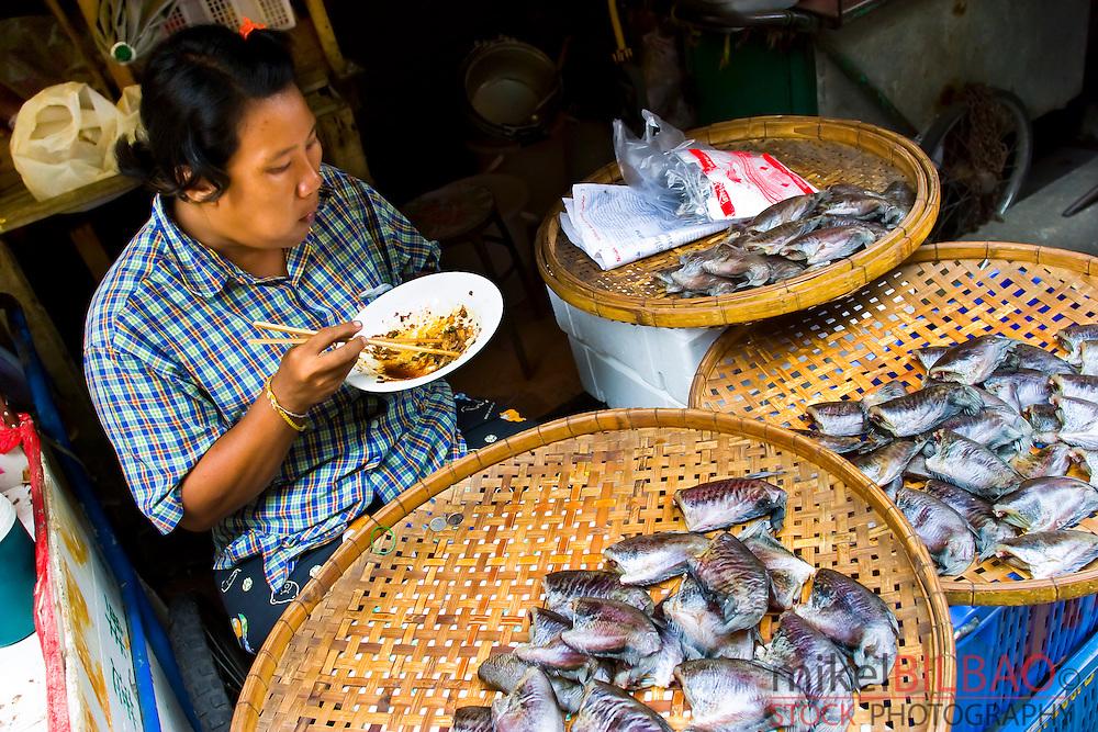 Fish peddler. Chinatown. Bangkok. Thailand.