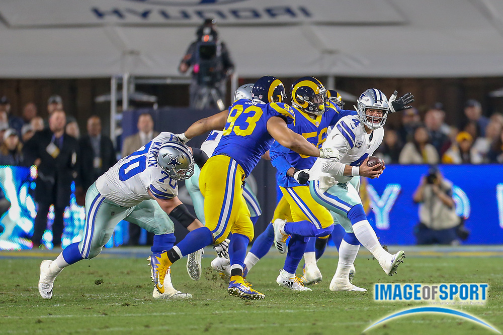 Jan 12, 2019; Los Angeles, CA, USA;  Dallas Cowboys quarterback Dak Prescott (4) is pressured by Los Angeles Rams defensive tackles Ndamukong Suh (93) and Matt Longacre (96) during an NFL divisional playoff game at the Los Angeles Coliseum. The Rams beat the Cowboys 30-22. (Kim Hukari/Image of Sport)