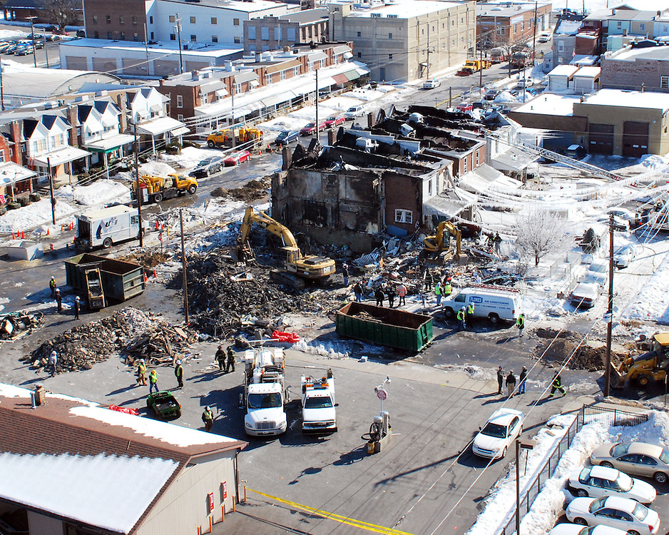 2/10/2011 Allentown, PA Rescue workers sift through the rubble on Thursday following a multiple fatality explosion near the intersection of 13th and Allen Street. Express-Times Photo |CHRIS POST
