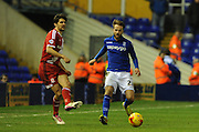 George Friend gets his pass away despite the attentions of Andrew Shinnie during the Sky Bet Championship match between Birmingham City and Middlesbrough at St Andrews, Birmingham, England on 18 February 2015. Photo by Simon Kimber.