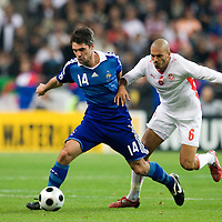 14 October 2008: French midfielder Jeremy Toulalan #14 vies with Tunisian midfielder Houcine Ragued #6 during the friendly football match won 3-1 by France over Tunisia on October 14, 2008, at the Stade de France in Saint-Denis, near Paris, France.