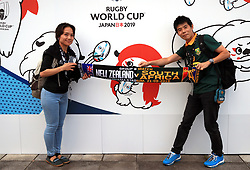 Fans hold a New Zealand v South Africa scarf ahead of the 2019 Rugby World Cup Pool B match at International Stadium Yokohama, Yokohama City.