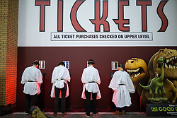 © Licensed to London News Pictures . 16/12/2015 . Manchester , UK . Four men dressed as Princess Leia at the ticket machines . Star Wars fans attend the midnight screening of Star Wars the Force Awakens at the AMC Great Northern cinema in Manchester City Centre . Photo credit : Joel Goodman/LNP