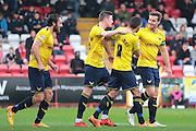 Oxford United midfielder Liam Sercombe celebrates with team mates after his goal during the Sky Bet League 2 match between Stevenage and Oxford United at the Lamex Stadium, Stevenage, England on 31 October 2015. Photo by Jemma Phillips.
