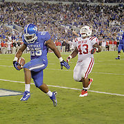 September 15, 2012 - Lexington, Kentucky, USA - UK's JONATHAN GEORGE scores a touchdown ahead of WKU'S JAMARCUS ALLEN in the second half as Western Kentucky University defeated the University of Kentucky, 32-31, on a trick play in overtime. (Credit Image: © David Stephenson/ZUMA Press).