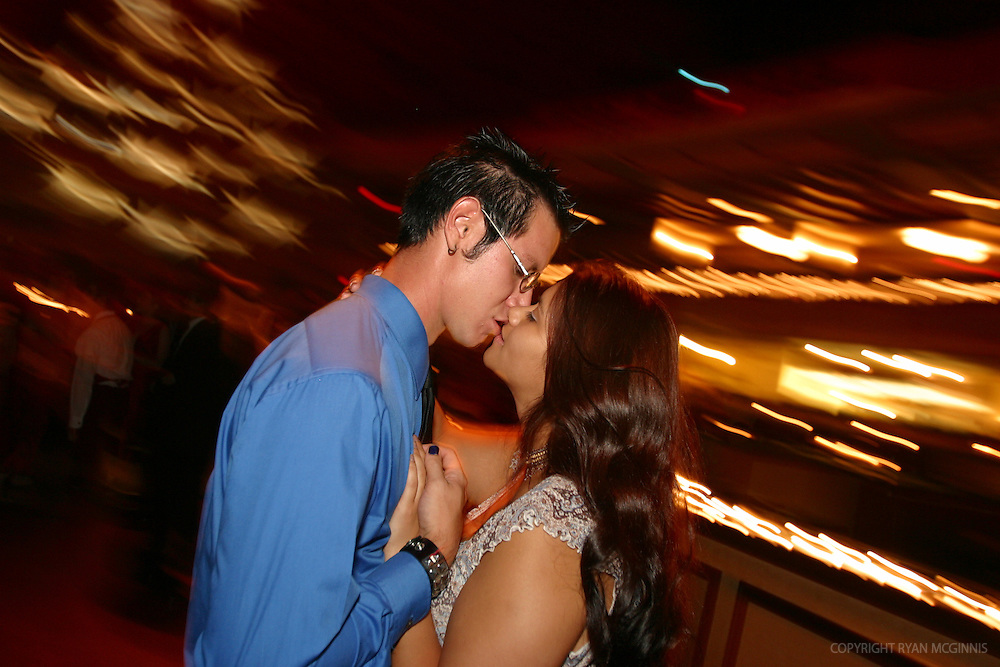 A couple kisses at a wedding dance, July 10, 2004.