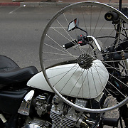 Bicycle rear wheel on motorcycle in Downtown Tucson. Bike-tography by Martha Retallick.