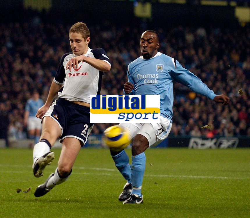 Photo: Jed Wee.<br /> Manchester City v Tottenham Hotspur. The Barclays Premiership. 04/01/2006.<br /> <br /> Tottenham's Michael Dawson (L) hooks the ball away from Manchester City's Darius Vassell.