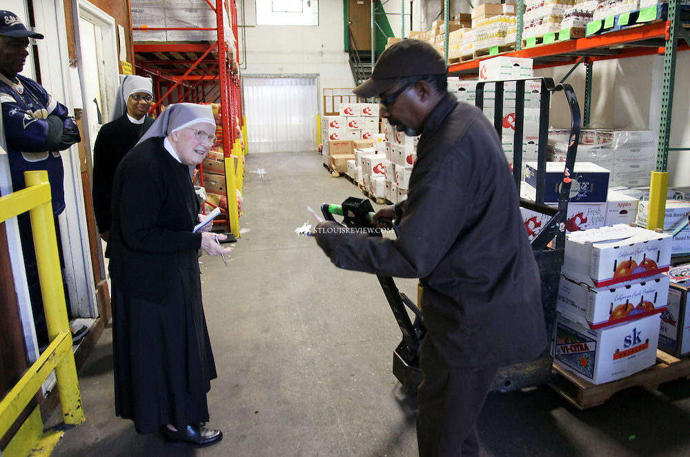 Sister Irene Marie Claire and Sister Emmanual Maria Talley of Little Sisters of the Poor begged for donations on Produce Row in North St Louis.