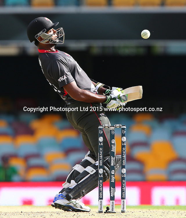 Amjad Javed of UAE ducks under a bouncer during the ICC Cricket World Cup, Ireland v UAE at the Gabba, Brisbane, Australia. Wednesday 25 February 2015. Copyright Photo: Tertius Pickard/ www.photosport.co.nz