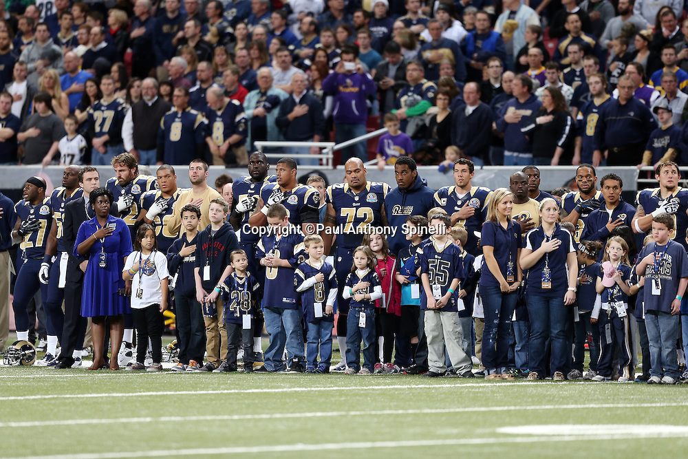 A group of St. Louis Rams players and young fans participate in a pregame ceremony in memory of the victims lost in the Sandy Hook Elementary School tragedy before the NFL week 15 football game against the Minnesota Vikings on Sunday, Dec. 16, 2012 in St. Louis. The Vikings won the game 36-22. ©Paul Anthony Spinelli