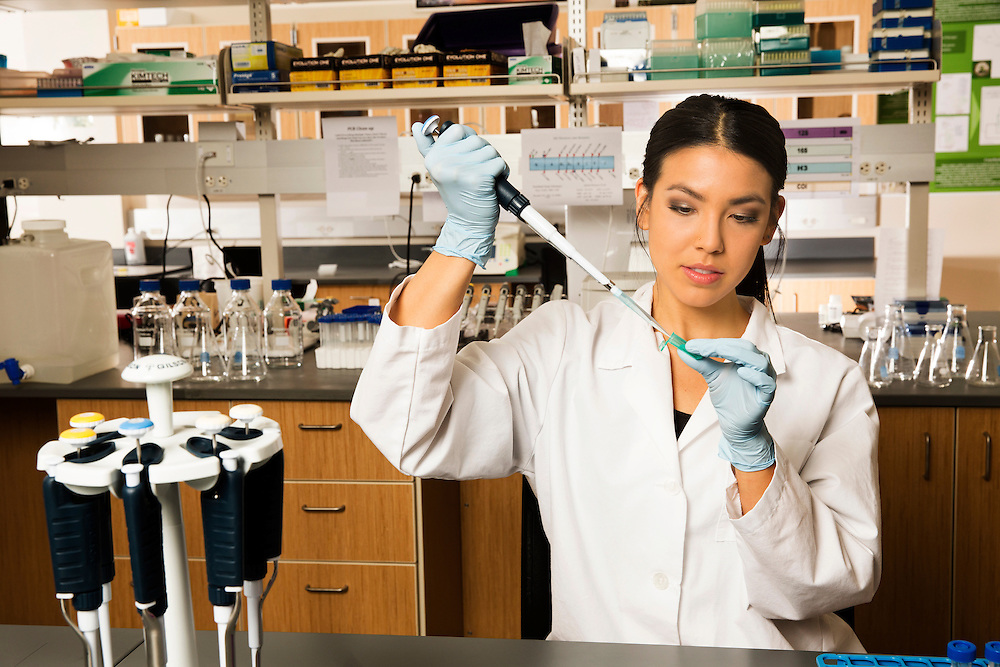 Stephanie poses for DNA billboard in room 168 of the Science Building on the campus of Utah Valley University in Orem, Utah Tuesday Feb. 26, 2013.
