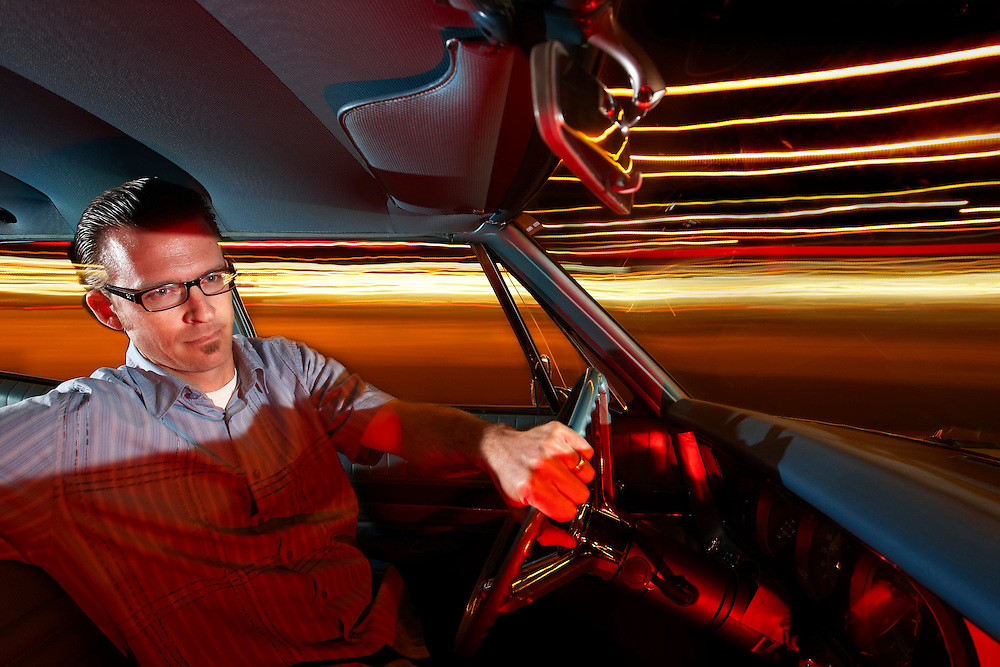 Portrait and pinup photographer Glen McDowell pictured in his vintage car in Salinas, California.