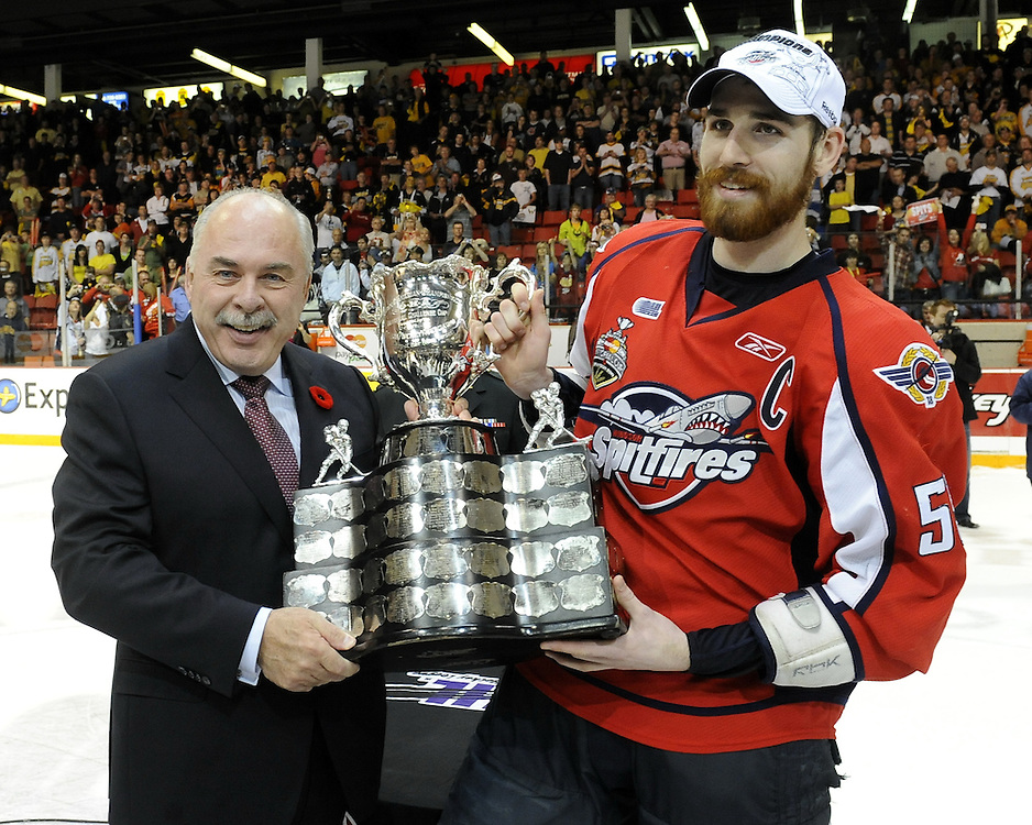 Harry Young accepts the Memroial Cup from CHL President David Branch after the Windsor Spitfires defeated the Brandon Wheat Kings in the championship game at the 2010 MasterCard Memorial Cup in Brandon, MB on Sunday May 23. Photo by Aaron Bell/CHL Images