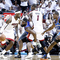 21 June 2012: Miami Heat small forward LeBron James (6) drives past Oklahoma City Thunder guard James Harden (13) on a screen set by Miami Heat power forward Chris Bosh (1) during the second quarter of Game 5 of the 2012 NBA Finals, at the AmericanAirlinesArena, Miami, Florida, USA.