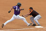 Kansas State's Eli Rumler (R) is out at first base, as Cowboy second basemen cover the bag on the play.  Oklahoma State defeated K-State 9-4 in 10 innings at Tointon Stadium in Manhattan, Kansas, April 30, 2006.