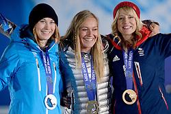 09-02-2014 ALGEMEEN: OLYMPIC GAMES MEDAILLE CEREMONIE: SOTSJI<br /> Huldiging op Medal Plaza / (L-R) Enni Rukajarvi FIN, Jamie Anderson USA, goud op slopestyle snowboarden en Jenny Jones GBR<br /> ©2014-FotoHoogendoorn.nl
