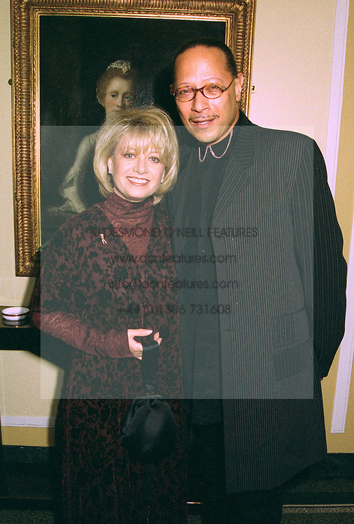 Singer ELAINE PAIGE and MR PETER STRAKER at a ball in London on 24th October 1997.MCK 13