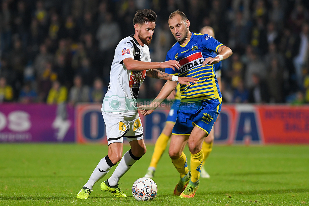 September 24, 2017 - Westerlo, BELGIUM - Roeselare's Thibaut Van Acker and Westerlo's Maxime Annys fight for the ball during a soccer game between KVC Westerlo and KSV Roeselare, in Westerlo, Sunday 24 September 2017, on the seventh day of the division 1B Proximus League competition of the Belgian soccer championship. BELGA PHOTO LUC CLAESSEN (Credit Image: © Luc Claessen/Belga via ZUMA Press)