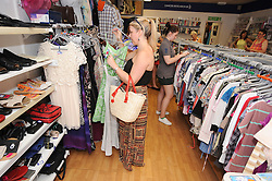 © London News Pictures. 14/07/2013. COPY AVAILABLE BELOW…. Shoppers at one of two Cancer Research UK charity shops on Orpington High Street, Kent. Orpington High street now has 12 charity shops  in one short stretch, with Cancer Research UK having two shops on different sides of the high street almost facing each other.  COPY AVAILABLE HERE:  http://tinyurl.com/nhtxtyd<br /> <br /> Photo credit :Grant Falvey/LNP
